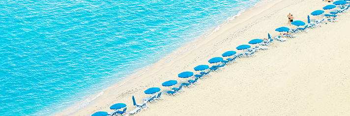 Chairs with Umbrellas on Florida Beach    GettyImages-57310516